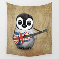 british flag Wall Tapestries featuring Baby Penguin Playing Union Jack British Flag Guitar by Jeff Bartels