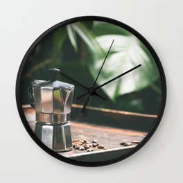 Coffee maker pot and cups on tropical leaves background Wall Clock