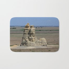 Castle Rock with blue sky Bath Mat