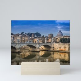 Tiber bridge in Rome with the Vatican City in the background Mini Art Print