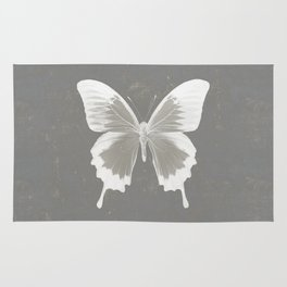 Butterfly on grunge surface Rug