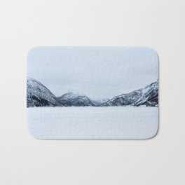 Blinded by the Norwegian snow Bath Mat