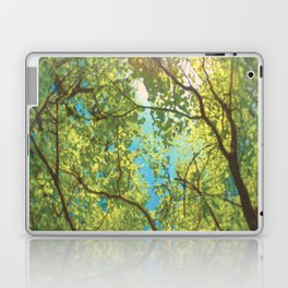 Canopy of trees with sun beaming through in vivid green and blue Laptop & iPad Skin
