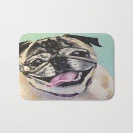 Portrait of Pug on Teal Bath Mat