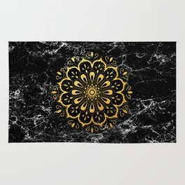 Gold mandala on black marble Rug