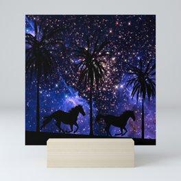 Galloping horses under starry sky Mini Art Print