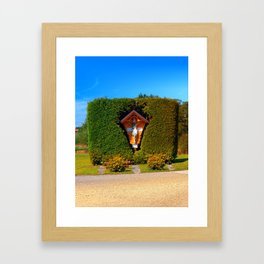 Jesus, a cross and a trimmed bush Framed Art Print