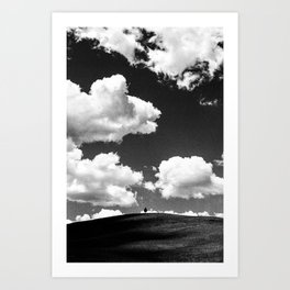 A lone tree under a heavy white cloud in black and white Art Print