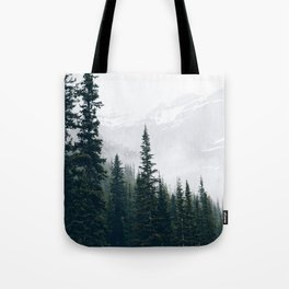 Evergreens in the fog Tote Bag