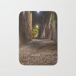 Medieval street that goes up narrow towards Bergamo Alta in the night Bath Mat