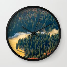 Fog rolling on a lonely autumn field Wall Clock