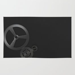 Set of metal gears and cogs on black Rug