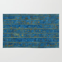 Golden Embossed Egyptian hieroglyphs on blue Rug