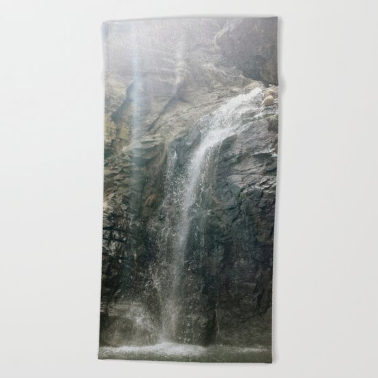 """Sunrays through the waterfall"" Beach Towel"