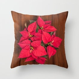 Red Christmas flower on brown wood Throw Pillow