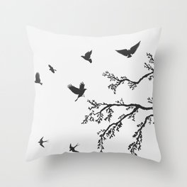 flock of flying birds on tree branch Throw Pillow
