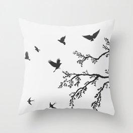 flock of flying birds on tree branch Throw Pillow