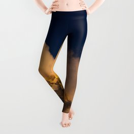 Sun lit mountains covered by clouds Leggings