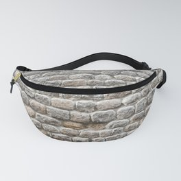 Close up view of the textured stone wall of a historical building Fanny Pack
