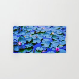 Water lilies in a pond Hand & Bath Towel