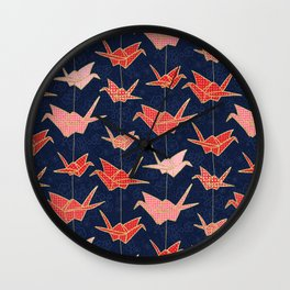 Red origami cranes on navy blue Wall Clock