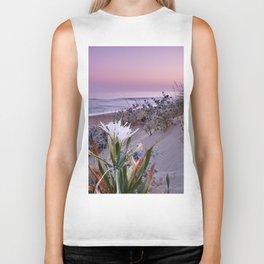 Sea daffodil. Beach at sunset Biker Tank