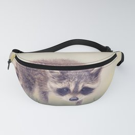 Cute Baby raccoon walking in the grass Fanny Pack