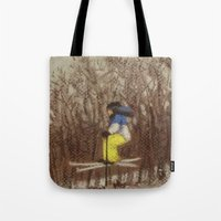 skiing Tote Bags featuring Child Skiing by Marnie