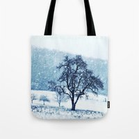 Tote Bags featuring Old pear tree (cool edition) by Pirmin Nohr