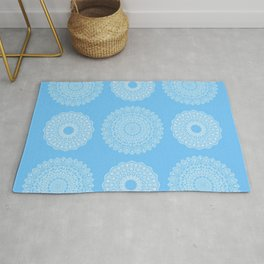 Pattern of white snowflakes on a blue background Rug