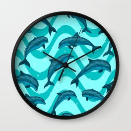 A flock of dolphins in the sea. Marine seamless pattern. Wall Clock