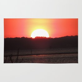 Sunset over water Rug