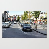 jane eyre Area & Throw Rugs featuring Taxi Stand, Eyre Square, Galway by Flattering Images