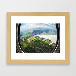 View through airplane porthole  Framed Art Print
