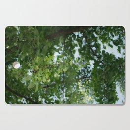 Ginkgo biloba tree in the city Cutting Board