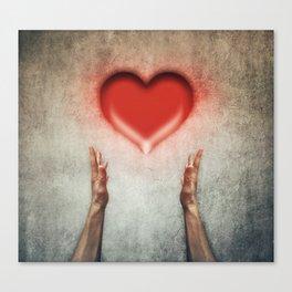 heart holding Canvas Print