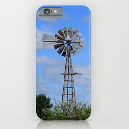 Kansas colorful sky with white clouds and a Windmill in a Pasture with tree's. iPhone Case