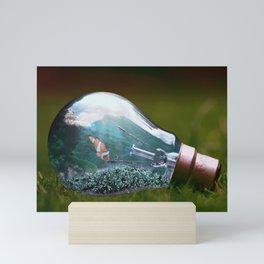 Life in a Light Bulb Mini Art Print