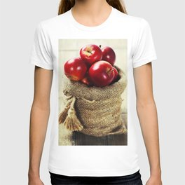Burlap sack with apples on a wooden table T-shirt