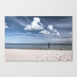 Lonely man at the beach Canvas Print