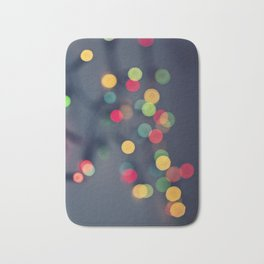 Blurred background with multicolored lights of garland Bath Mat