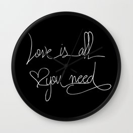 Love is all you need white hand lettering on black Wall Clock