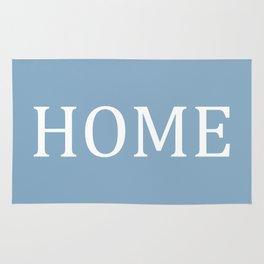 Home word on placid blue background Rug