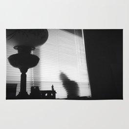 Hurricane Lamp and Cat B/W Rug
