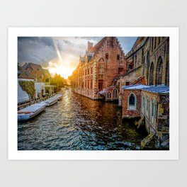Sunset over river amidst city in Brujas Art Print