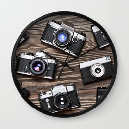 Collection of retro photo cameras on  wood Wall Clock
