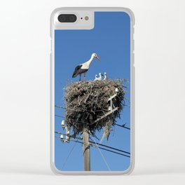 A stork family on a telegraph pole Clear iPhone Case