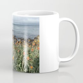Orange blooms along the Pacific Coffee Mug