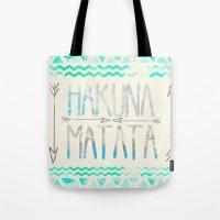 hakuna Tote Bags featuring Hakuna Matata by Sara Eshak