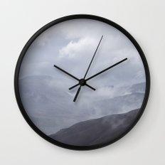 Rain clouds rolling through the mountains. Cumbria, UK. Wall Clock